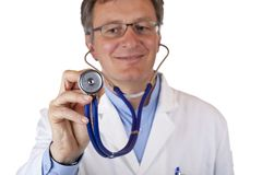 Closeup of a smiling doctor holding a stethoscope Stock Images