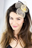 Closeup of smiling female model with flower in hair Royalty Free Stock Photo