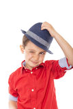Closeup of a smiling little boy blinking holding a hat Royalty Free Stock Image