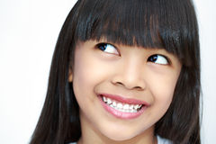 Closeup smiling little child looking up Stock Images