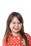 Closeup of a smiling little girl blinking. Over white background Stock Images