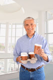 Businessman with Coffee Tray Stock Images
