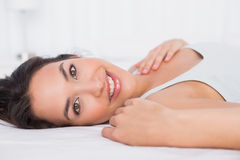Closeup of a smiling pretty woman relaxing in bed Stock Photo