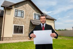 Closeup on smiling real estate agent ready to sell house. Stock Photos
