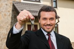Closeup on smiling real estate agent ready to sell house. Stock Images