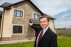 Closeup on smiling real estate agent ready to sell house Royalty Free Stock Photo