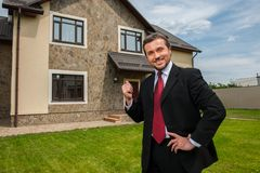 Closeup on smiling real estate agent ready to sell house. Stock Photography