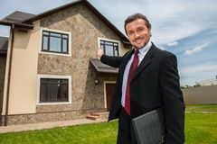 Closeup on smiling real estate agent ready to sell house. Stock Photo