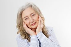 Closeup of smiling senior woman wrinkle face and gray hair. Old mature lady touching her wrinkled skin isolated on white. Background. Copy space stock image