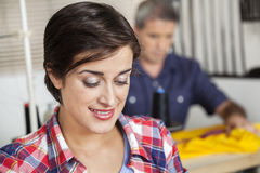 Closeup Of Smiling Tailor At Sewing Factory Royalty Free Stock Photography