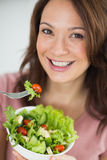 Closeup of smiling woman with bowl of salad Royalty Free Stock Photo