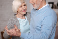 Closeup of smiling woman dancing with husband stock images