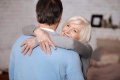 Closeup of smiling woman emracing husband royalty free stock photos