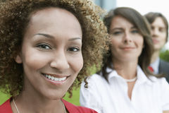 Closeup Of Smiling Woman With Friends Behind Stock Image
