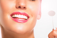 Closeup of smiling woman with perfect white teeth Stock Photography