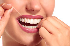 Closeup of smiling woman with perfect white teeth. On white Stock Photo