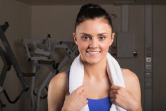 Closeup of a smiling woman with towel in gym Royalty Free Stock Image