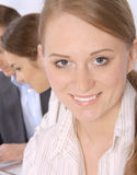 Closeup of a smiling young business woman Royalty Free Stock Photo