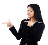 Closeup of smiling young businesswoman pointing to the end of th Stock Photo