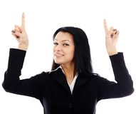 Closeup of smiling young businesswoman pointing to the top of th Stock Photos