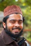 Closeup of smiling young Muslim man in Delhi. Royalty Free Stock Images
