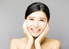 Closeup  smiling young  woman face with clean  skin Royalty Free Stock Image