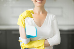 Closeup of smiling young woman at the kitchen Stock Photos