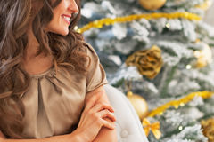 Closeup on smiling young woman near christmas tree Stock Photography
