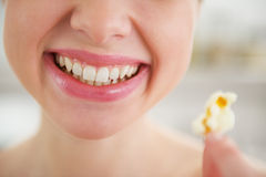 Closeup on smiling young woman with popcorn Stock Photo