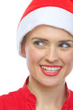Closeup on smiling young woman in Santa hat Stock Photo
