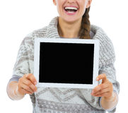 Closeup on smiling young woman showing tablet pc blank screen Stock Images