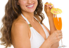 Closeup on smiling woman in swimsuit with cocktail Stock Images
