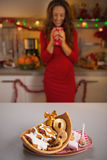 Closeup on snacks on table and housewife in background Royalty Free Stock Photos