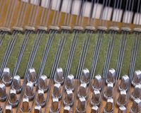 Snares pins and mutes inside old bechstein grand piano. Closeup of snares pins and mutes inside old bechstein grand piano Royalty Free Stock Photos