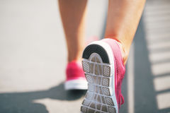 Closeup on sneaker of fitness young woman Stock Photo