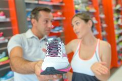 Closeup sneaker in sports shop Royalty Free Stock Photos