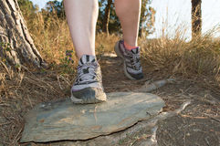 Closeup of sneakers of sport people in mountain trail Stock Photo