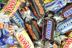 Closeup of Snickers, Mars, Bounty, Milky Way,Twix candies. Stock Photos