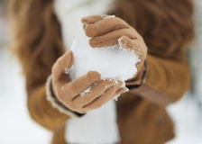 Closeup on snow ball in woman hand Royalty Free Stock Images