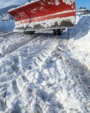 Closeup of snowy road and snow plow truck Royalty Free Stock Photo