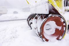 Closeup of a snowy snow plow Royalty Free Stock Photography
