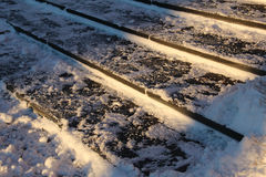 Closeup snowy stairs in winter Stock Photos