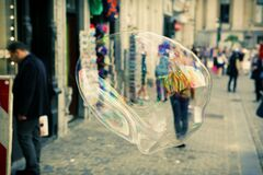 Closeup of soap bubble in city