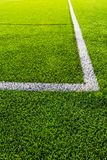 Soccer field corner, green artificial grass. royalty free stock photo