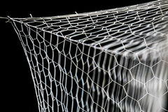 Closeup of soccer goal net. On black Stock Photography