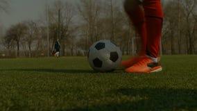 Footballer kicking soccer ball during free kick stock video