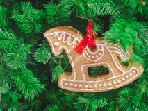 Closeup Soft focus horse gingerbread decorate on christmas tree. ChristmasDay Background royalty free stock photography