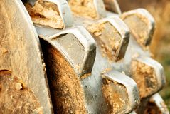 A soil compactor on a track hoe showing a closeup of the teeth. stock photography