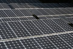 Closeup of solar panel. Large solar panels in the rainforest. Alternative solar energy stock photo