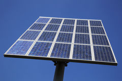 Closeup of solar panels and blue sky Stock Photos